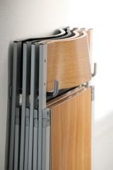Pocket klapstoel aan muurbeugel